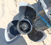 foto of outboard  - Propeller of the Old Disassembled Boat Outboard Motor - JPG