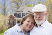 stock photo of yard sale  - Attractive Happy Senior Couple in Front Yard of House - JPG