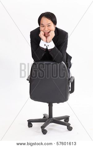 Isolated Businessman Sitting On Chair