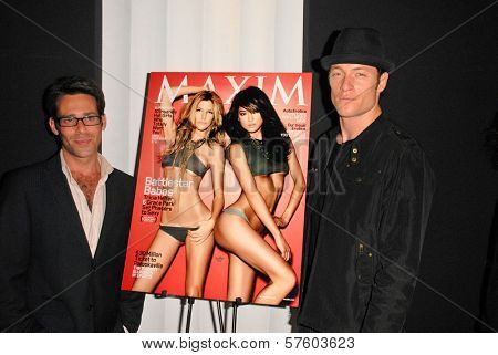 James Callis and Tahmoh Penikett  at the Maxim Cover party featuring Tricia Helfer and Grace Park, MI6, West Hollywood, CA.  10-20-09