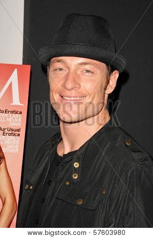 Tahmoh Penikett at the Maxim Cover party featuring Tricia Helfer and Grace Park, MI6, West Hollywood, CA.  10-20-09