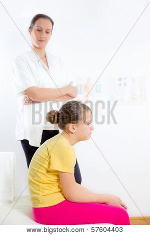 Femile Chiropractor doing adjustment on female patient