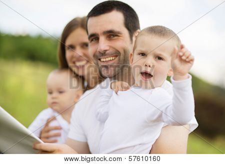 Happy family is reading book