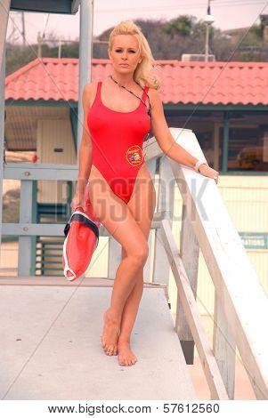 Katie Lohmann on Halloween, wearing an authentic Baywatch swimsuit from the TV series, Zuma Beach, CA. 10-31-09