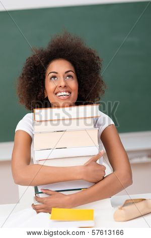Joyful Student Hugging Her Text Books
