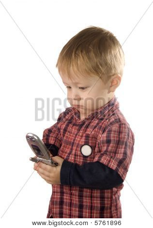 Small Boy Is Browsing The Snapshots On Mobile Phone Isolated Against White
