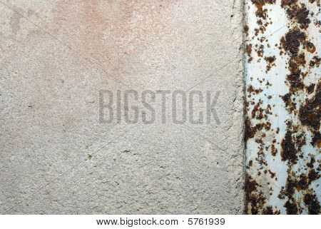 Old Concrete Wall Made Of Cement With Rusty Metal Border. Abstract Textured Background.