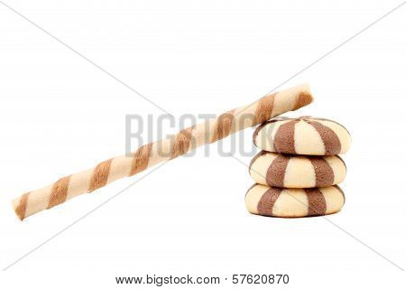 Striped chocolate wafer rolls and stake biscuits.