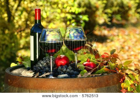 Glasses Of Red Wine On Old Barrel