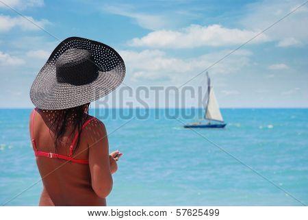 Suntanned Woman On A Beach