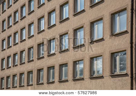 Background Of Unpainted Concrete Building