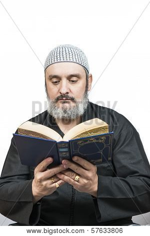 Muslim Man Reading The Quran.
