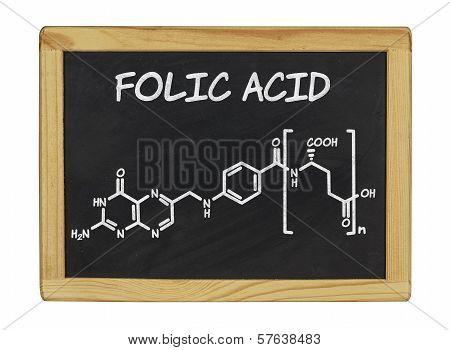 chemical formula of folic acid on a blackboard