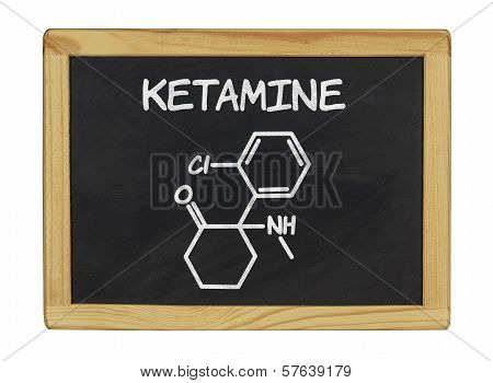 chemical formula of ketamine on a blackboard
