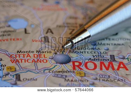 Pen Pointing At Rome On The Map