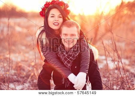 Happy young couple smiling and hugging