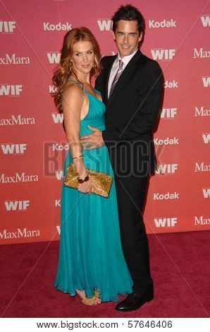 Poppy Montgomery and Adam Kaufman at the Women In Film 2009 Crystal And Lucy Awards. Hyatt Regency Century Plaza, Century City, CA. 06-12-09