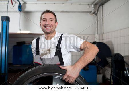Mechanic Smiling At Work
