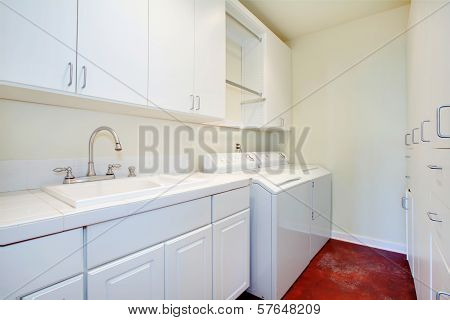 White Laundry Room With A Red Floor
