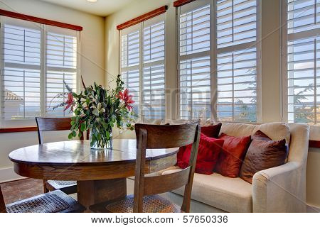 Beautiful Soft Colors Dining Area With Wooden Rustic Table