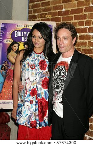 Pooja Kumar and Chris Kattan at the Los Angeles Premiere of 'Bollywood Hero'. Cinespace, Hollywood, CA. 07-27-09