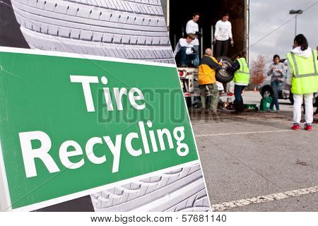 Volunteers Collect Worn Tires At Recycling Event