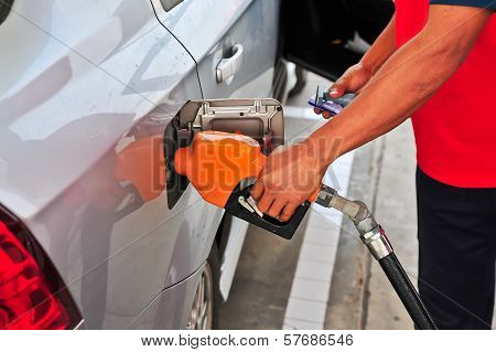 Man's Hand Holding A Gas Pump