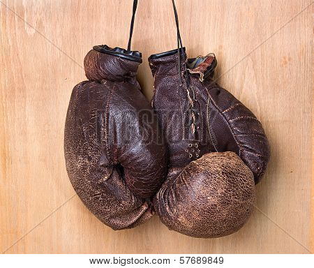 Old Boxing Gloves Hang On Nail On Wall