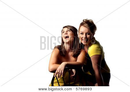 Two young women sharing a joke