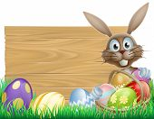 stock photo of ester  - Easter wood sign with the Easter bunny and chocolate Easter eggs - JPG
