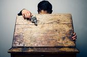 stock photo of mayhem  - Student At School Desk With a Gun in his hand - JPG
