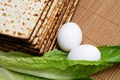 stock photo of seder  - Matzot eggs and lettuce  - JPG