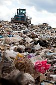 stock photo of landfills  - Truck moving garbage in a landfill site - JPG