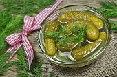picture of pickled vegetables  - Homemade pickles in brine with red ribbon - JPG