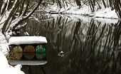 image of pontoon boat  - river with handmade pontoon from barrels covered with snow - JPG