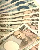 pic of ten thousand dollars  - ten thousand yen currency of Japan closeup