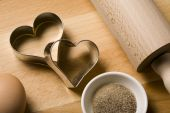 Heart Shaped Cookie Cutters And Baking Ingredients Close Up
