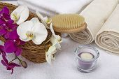 Bath Brush, Rolled Towels, Tealight And Orchids