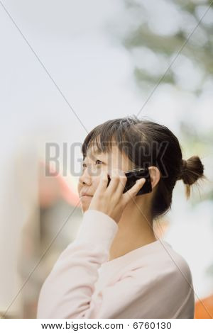 Young Woman Outdoors With Cell Phone
