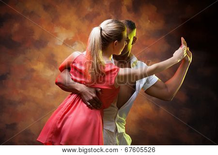 Young couple dances Caribbean Salsa