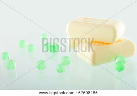 Three Soap Bars On The Greenish Background