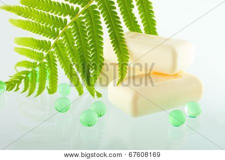 The Soap Bars On The Greenish Background