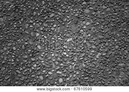 Closeup of textured pebbles pavement