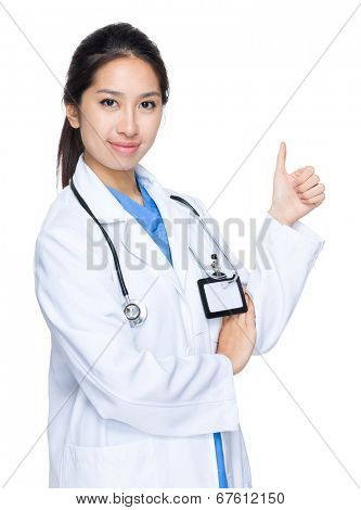 Female doctor with thumb up