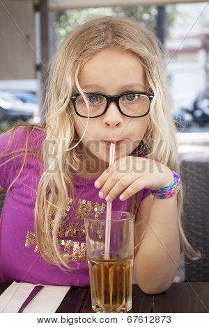 Child With Drink And Straw