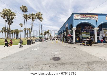 LOS ANGELES, CALIFORNIA - June 20, 2014:  View of Southern California's famously funky Venice Beach boardwalk in the city of Los Angeles, California.