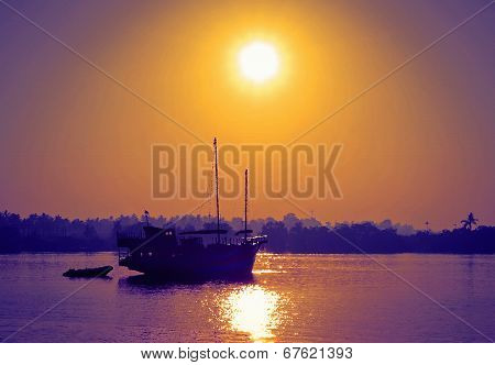 Wooden Boat On River In The Sunrise