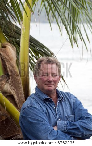 Man In Tropical Setting