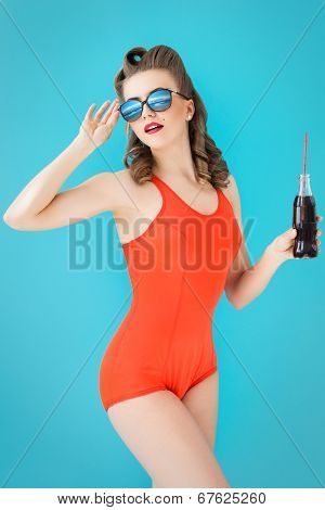 Pinup, summer. Attractive woman in red swimsuit