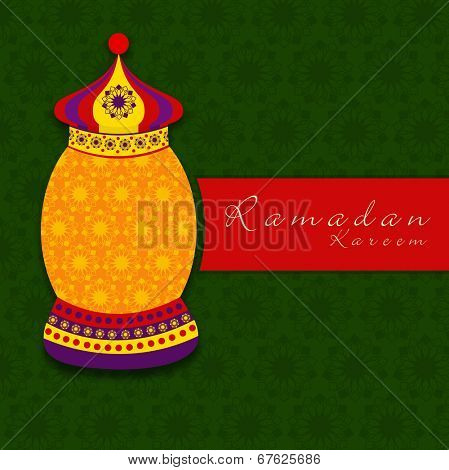 Beautiful floral decorated arabic lantern on green and red background for holy month of Muslim community Ramadan Kareem.